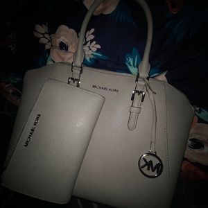Michael kors purse and wallet set .